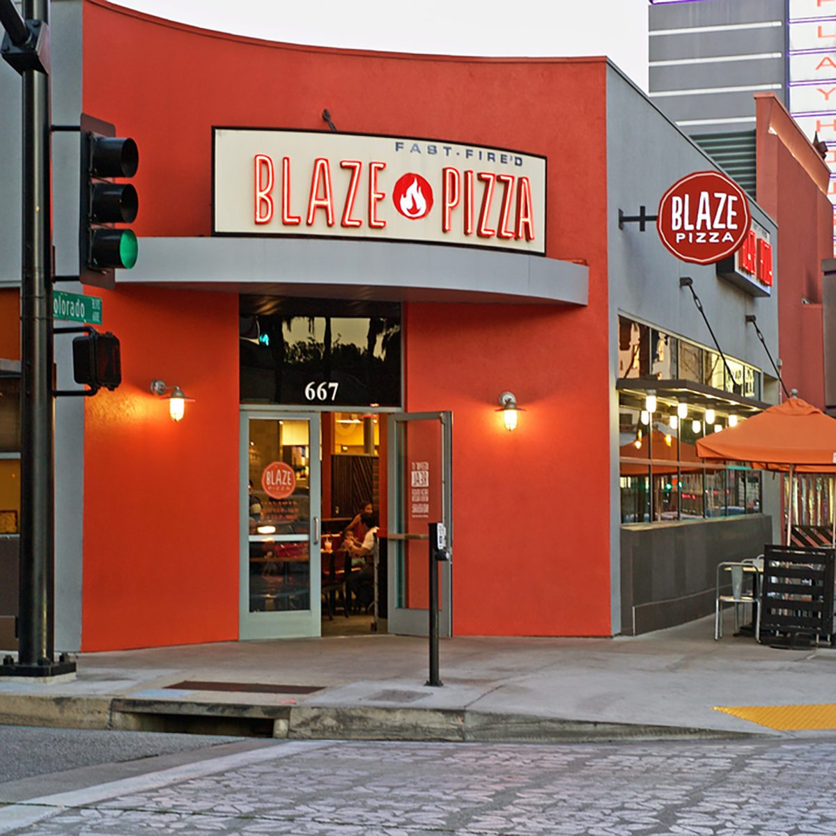 Building facade of the popular Blaze Pizza restaurant. Image was captured after sunset in Pasadena, California USA