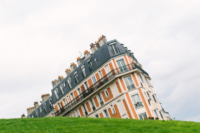 Sinking house on Montmartre hill taken with an unusual angle, Paris, France