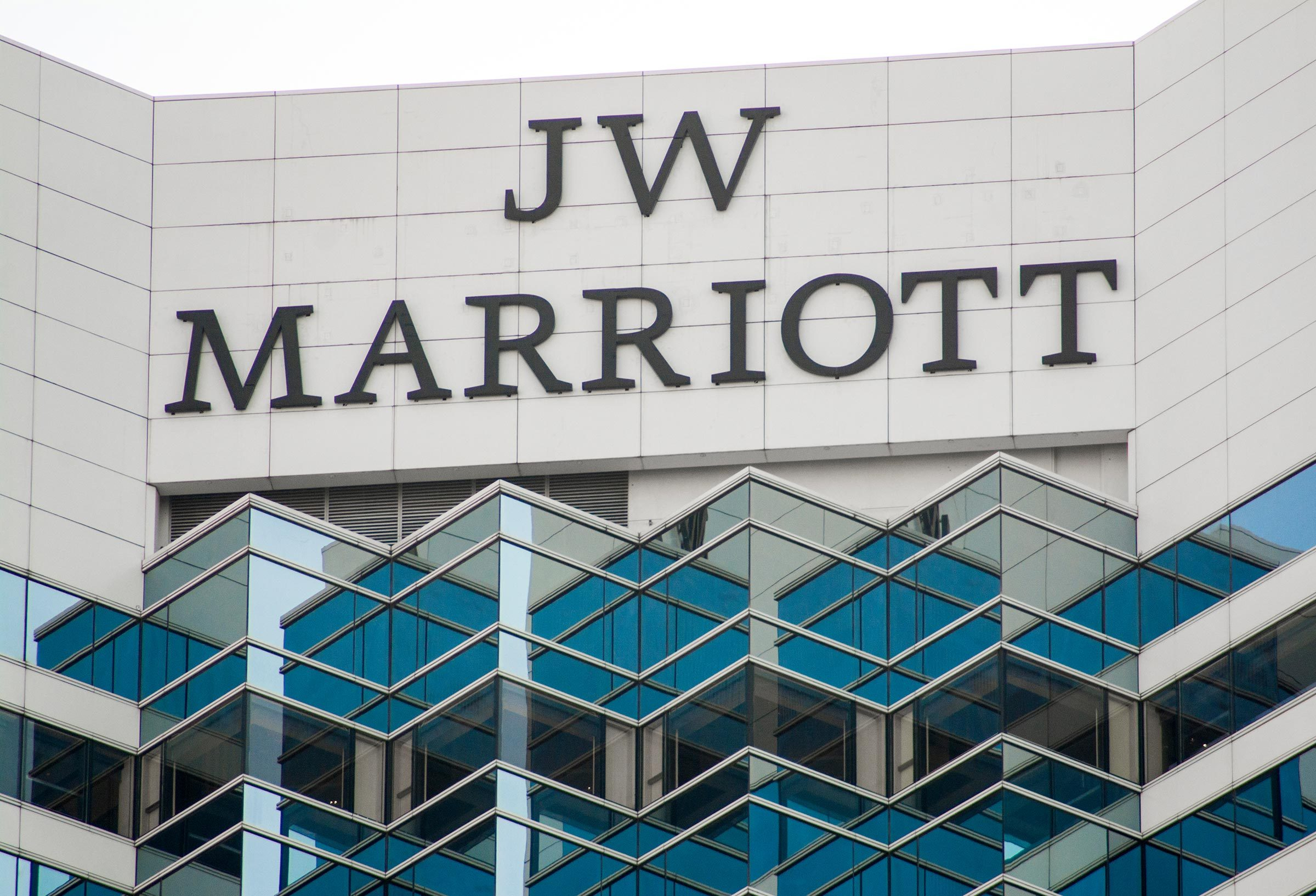 ADMIRALTY, HONG KONG - DEC 21, 2017: Logo of JW Marriott Hotel on the roof of the building. JW Marriott locates on top of Pacific Place Mall.