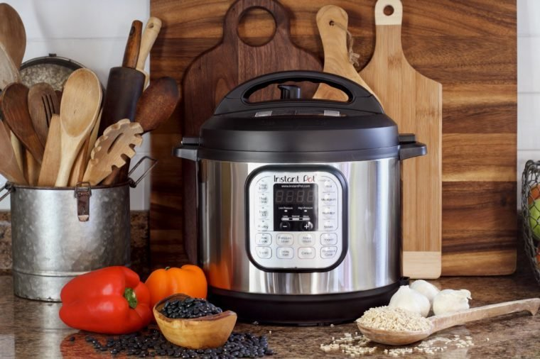 Breeding, KY, USA - January 08, 2019: Instant Pot pressure cooker on kitchen counter with beans and rice.