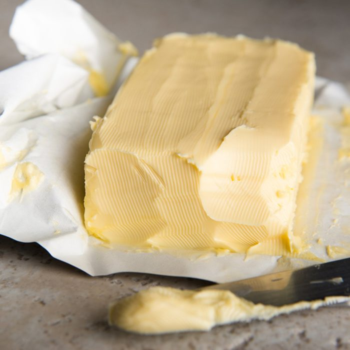 Large Softened Stick of Butter on Wrapping Ready to Eat; Shutterstock ID 171461966; Job (TFH, TOH, RD, BNB, CWM, CM): TOH