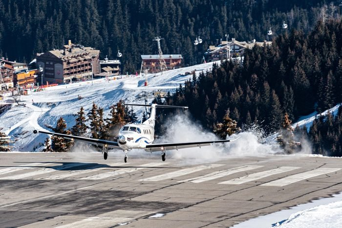 COURCHEVEL - FEBRUARY 25. A Pilatus PC12 during a dangerous landing where it has touched down before the runway! This private airplane brings skiers during French winter holidays on February 25, 2017.