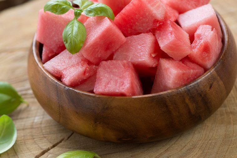 Wooden bowl with watermelon cubes, close-up, horizontal shot
