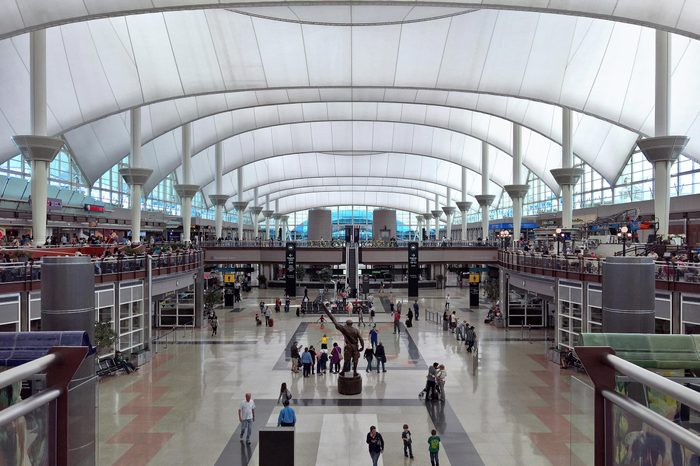 DENVER, CO - APRIL 23, 2016: Passengers traverse through the Jeppesen Terminal, (also known as the Great Hall) at Denver International Airport, DEN, a large hub airport in the central United States.