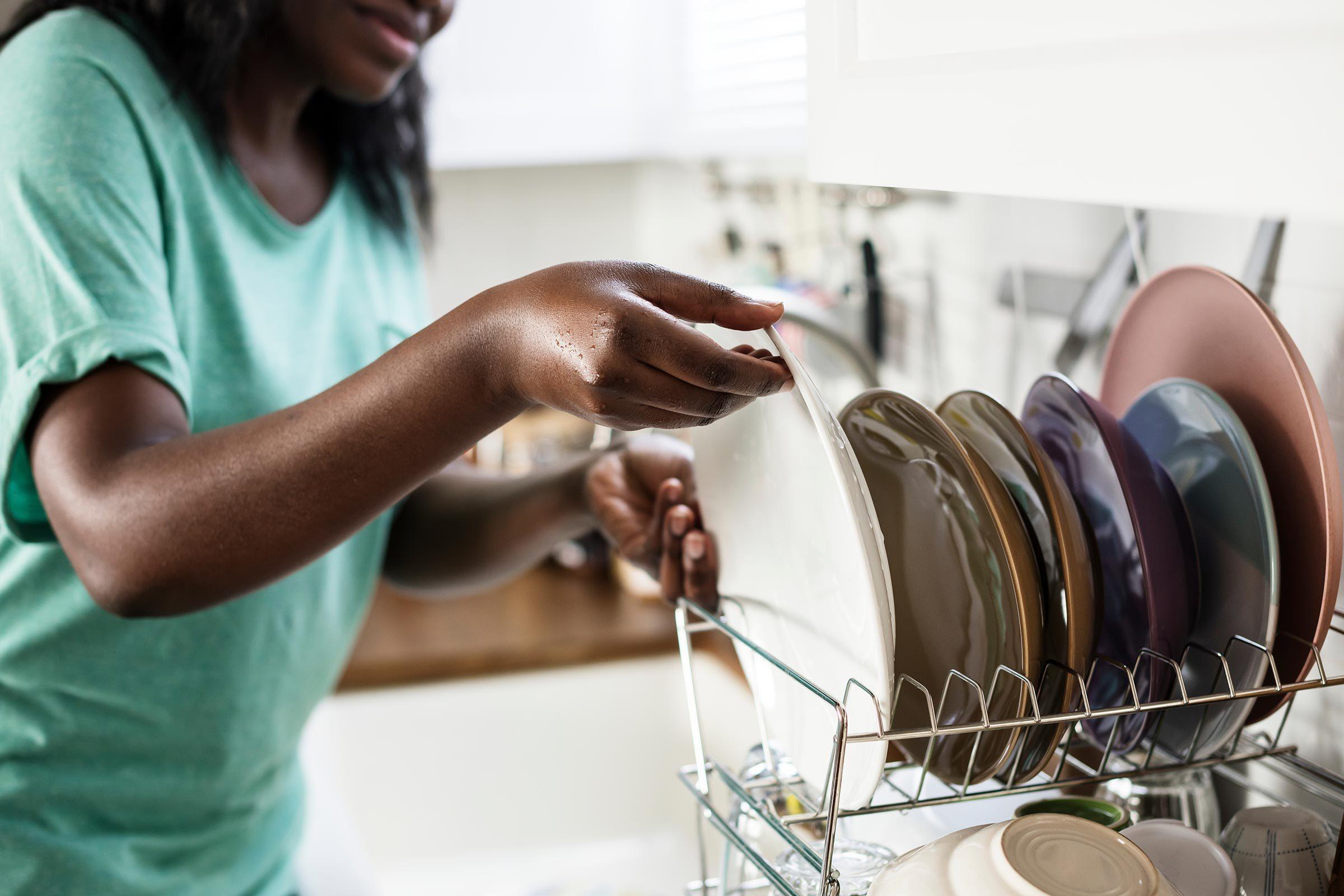 washing dishes hands kitchen sink