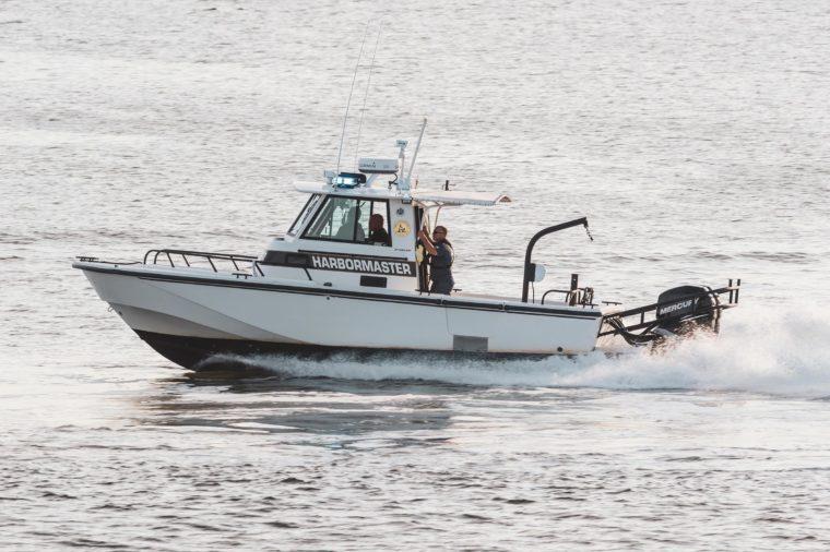 Fairhaven, Massachusetts, USA - August 31, 2018: Fairhaven harbormaster patrol boat heading toward Buzzards Bay