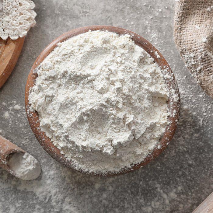 Bowl of wheat flour on light table, top view; Shutterstock ID 657369391; Job (TFH, TOH, RD, BNB, CWM, CM): TOH