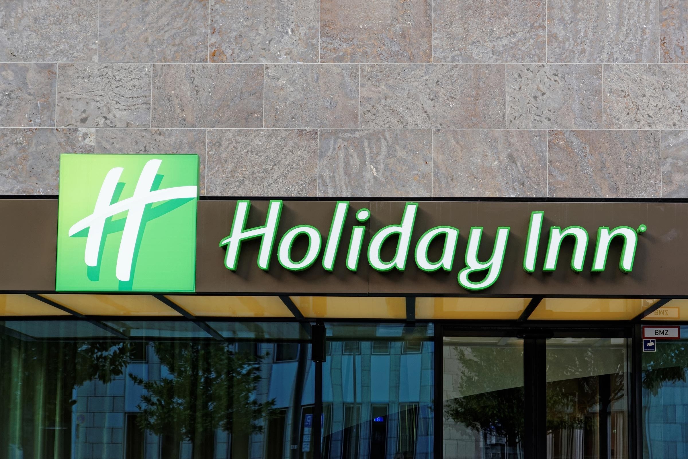 FRANKFURT AM MAIN, GERMANY - AUGUST 5, 2015: Holiday Inn hotel sign and logo. Holiday Inn is a multinational brand of hotels, part of the British InterContinental Hotels Group.
