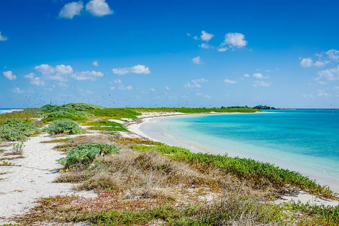 Garden Key, FL / USA - 02-09-2015: Beach and peninsula on Garden Key, closed seasonally for migrating bird nesting. Garden Key is one of the Florida islands forming Dry Tortugas National Park.