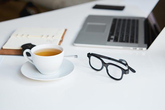 desk glasses laptop