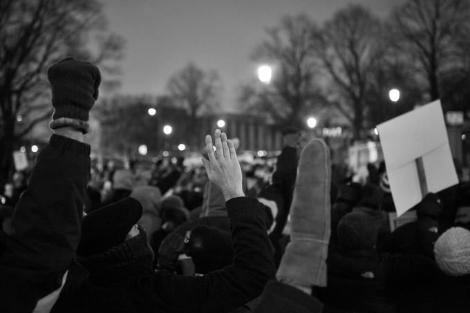 Hands Up -Des Moines, Iowa, USA - February 2, 2017: Protestors raise their hands a the march at the Iowa State Capitol to protest President Trump's Muslim Ban on February 2, 2017