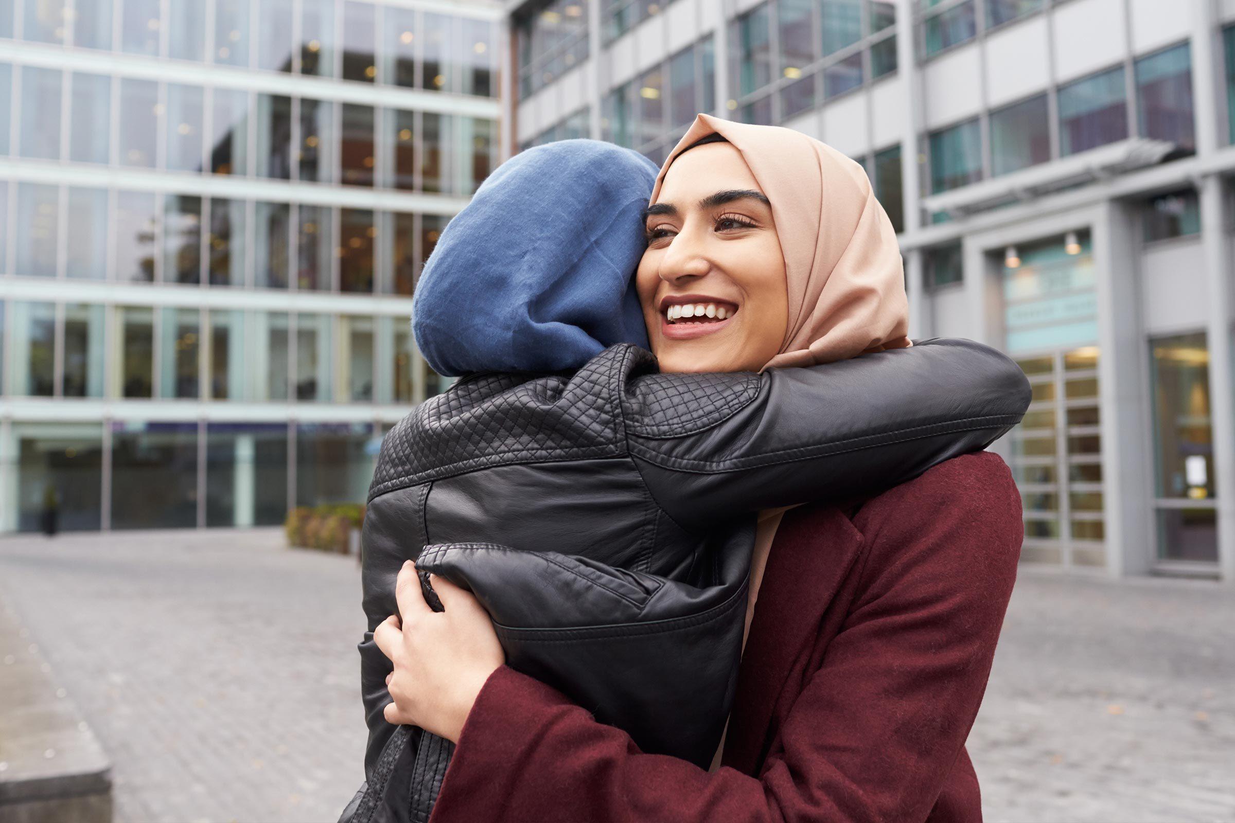 women hug