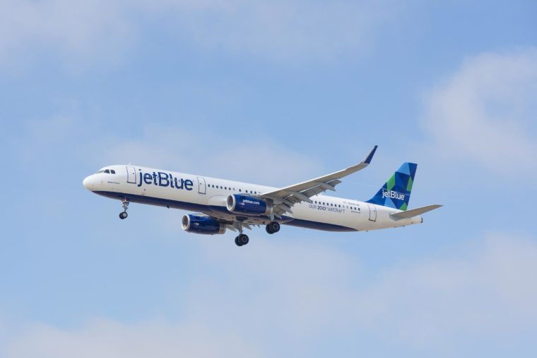 LOS ANGELES, CA/USA - JUNE 15, 2015: 'Memta Fresca' Jet Blue aircraft (Airbus A321, reg N942JB) in flight shortly before landing at the Los Angeles World Airport (LAX). 'Our 200th Aircraft' livery.