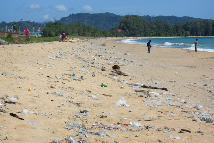 Mai Khao Beach, Phuket, Thailand - June 22,2018 : Dirty beach along the shoreline