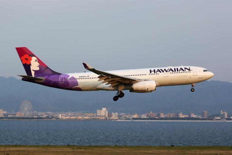 OSAKA, JAPAN - MAY 24: A Hawaiian Airlines Airbus A330 approaching on May 24, 2014 in Osaka. Hawaiian Airlines is a US airline based in Honolulu, Hawaii.