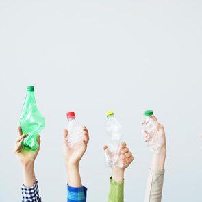 hands holding plastic bottles