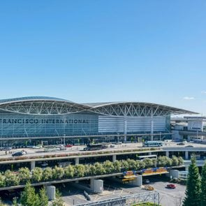 San Francisco, California, USA - January 21, 2019 : Exterior view of International terminal of San Francisco International Airport. Cars, buses and shuttles pick up and drop off passengers.