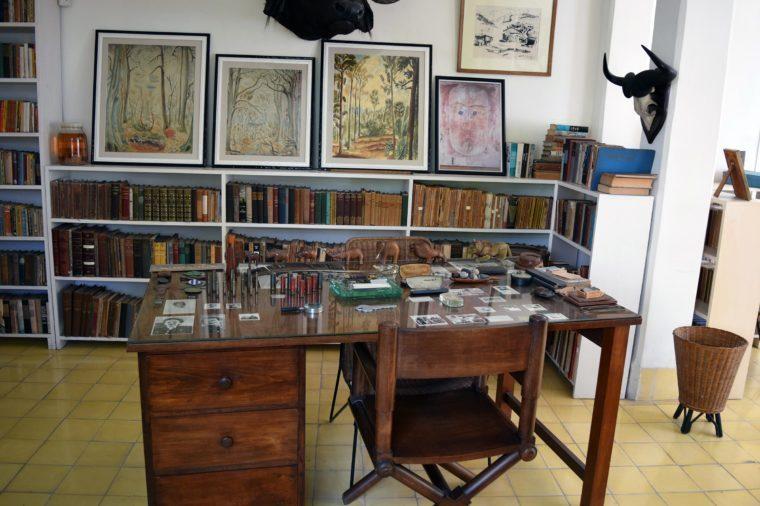 "SAN FRANCISCO DE PAULA, CUBA - JUNE 10th, 2016: Ernest Hemingway's house, Finca Vigia, near Havana, Cuba. It is now a museum. Most of ""For Whom the Bell Tolls"" was written here."