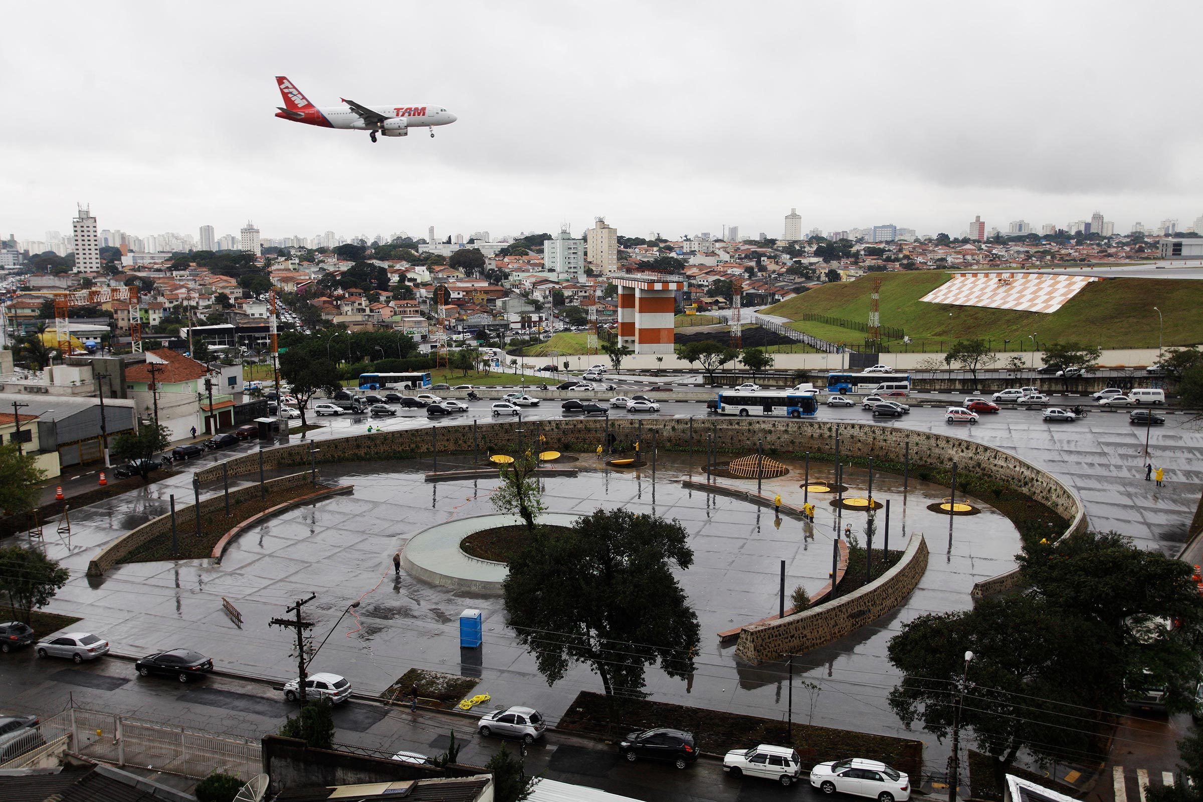 Sao Paulo, SP / Brazil - July 17, 2012: A plane of Brazil's TAM airline arrives in Congonhas airport past the site of the tragedy where an aircraft of TAM crashed and burst into flames in July17 2007.