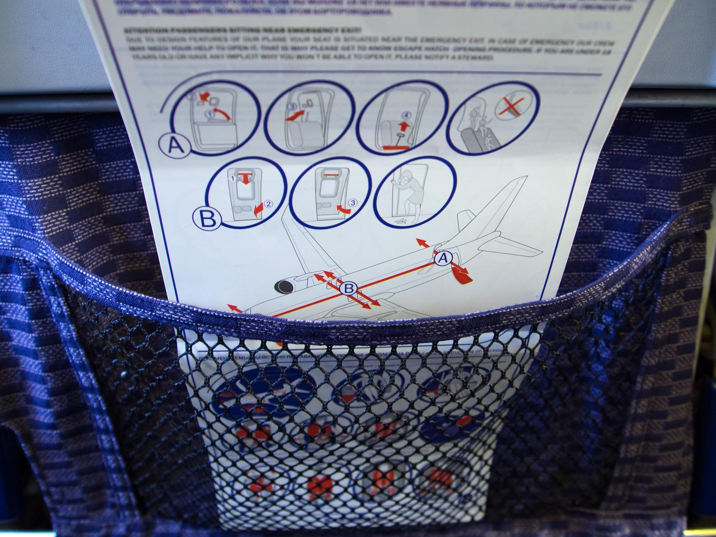 Safety instructions in the pocket of an airplane chair