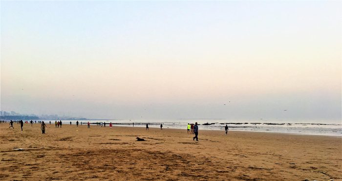 Early Morning view of Juhu Beach with unidentified morning walkers as on 1st April 2018.