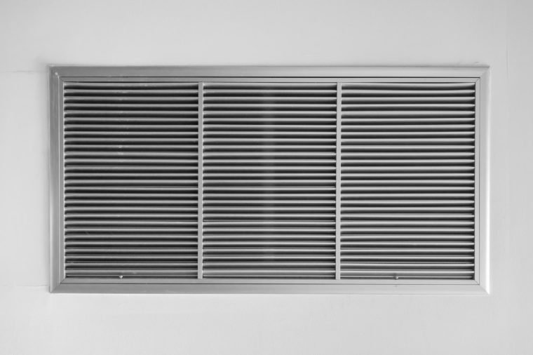 air ventilator ,metal slat frame on white wall background