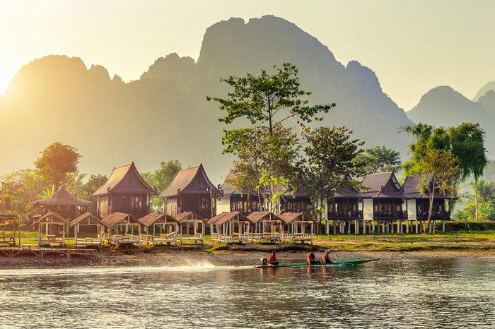 Village and bungalows along Nam Song River in Vang Vieng, Laos.
