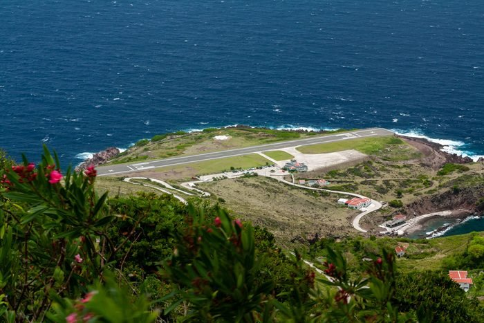 Airport, on island of Saba in Caribbean area, has one of the shortest runways in the world, only 400 metres long. Flanked on one side by high hills, with cliffs that drop into the sea at both ends.