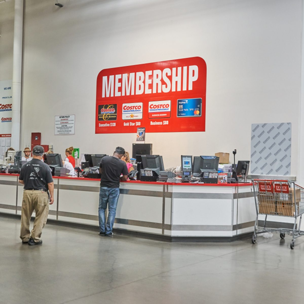 TORONTO, CANADA - AUGUST 15, 2018: Line of a people at customer service desk in a Costco store. Costco, is an American corporation which operates a chain of membership-only warehouse clubs.; Shutterstock ID 1182944260