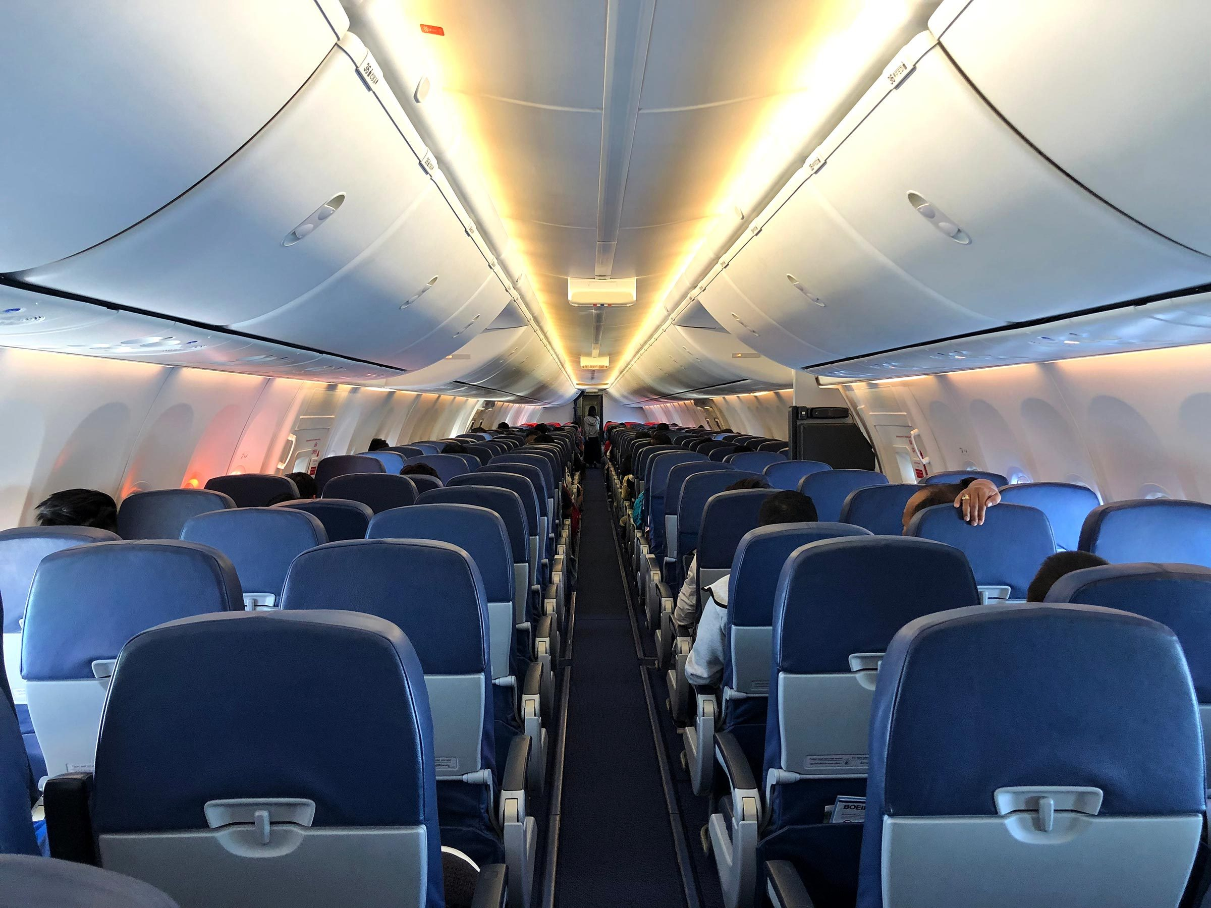 Inside the cabin of airplane with passengers