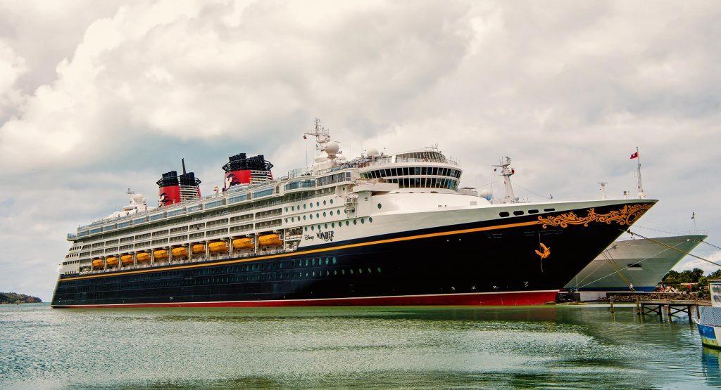 Nassau, Bahamas-January 15, 2016: Large luxury cruise ship Disney Wonder on sea water and cloudy sky background docked at port of Nassau, Bahamas