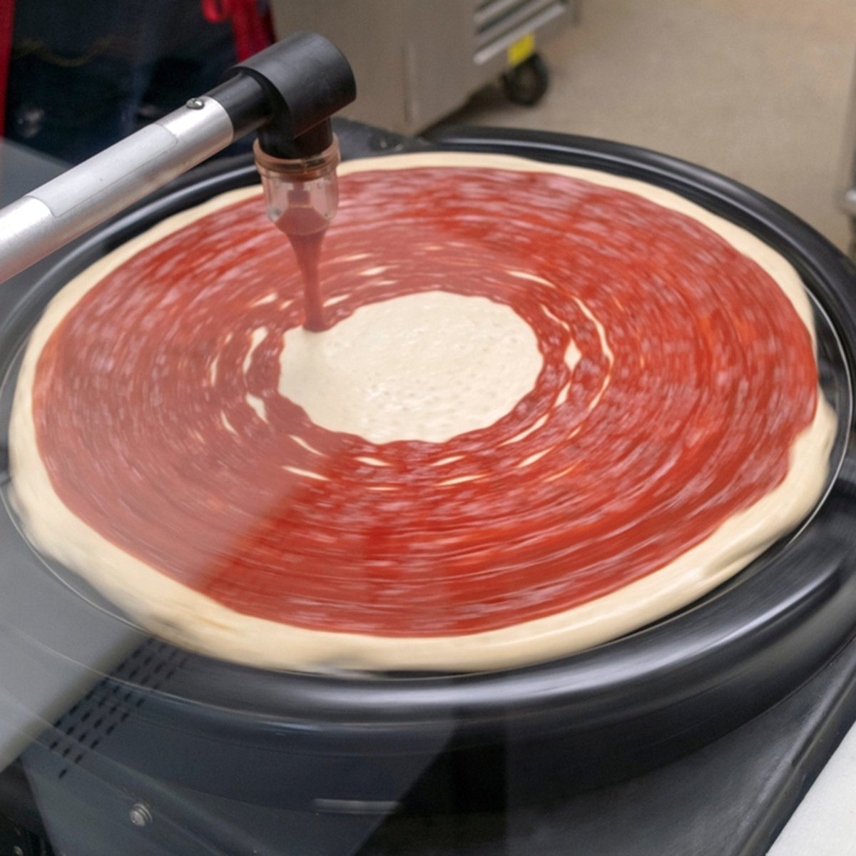 Automated pizza sauce delivery system with MOTION BLUR.; Shutterstock ID 1334030297; Job (TFH, TOH, RD, BNB, CWM, CM): TOH