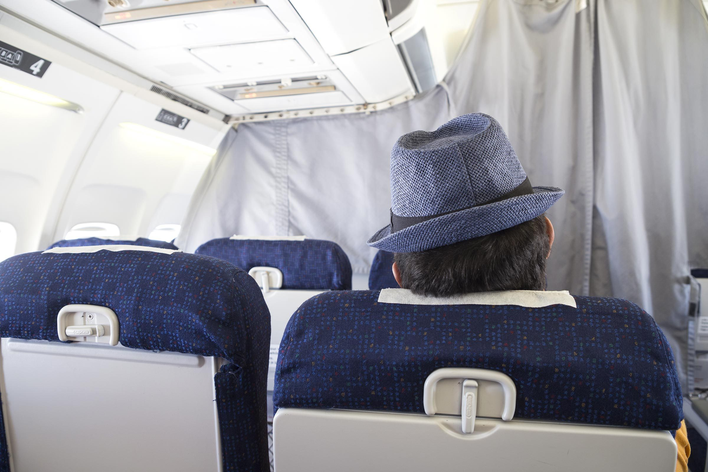 Aircraft cabin and passenger with hat