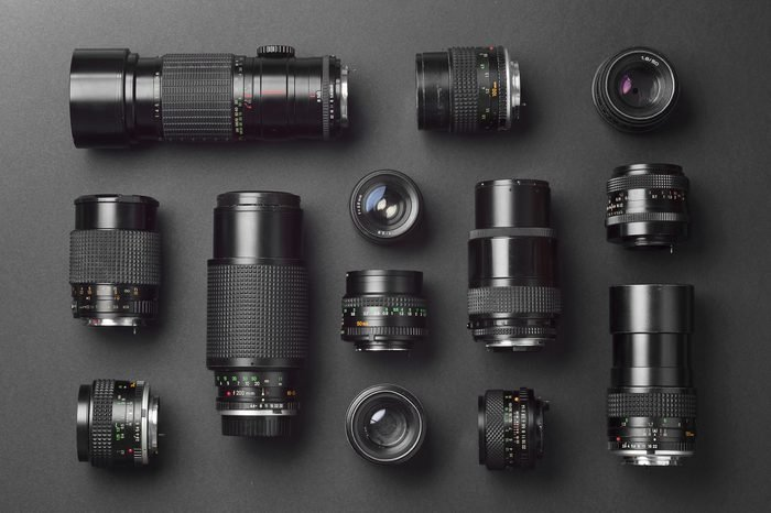 Collection of camera lens well organized over black background