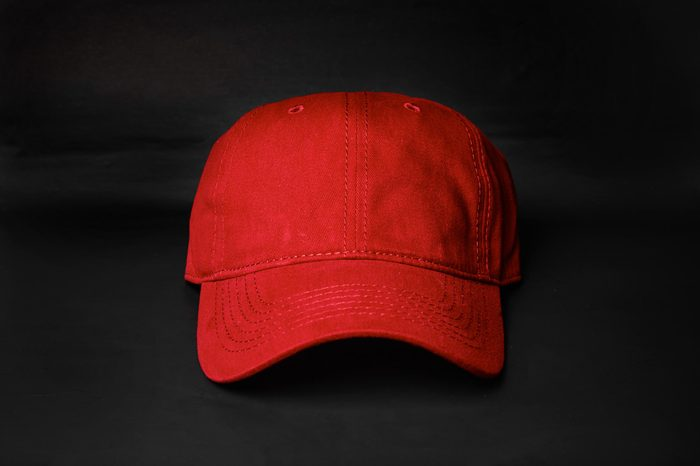 Cotton Red Cap on a black background, font view.