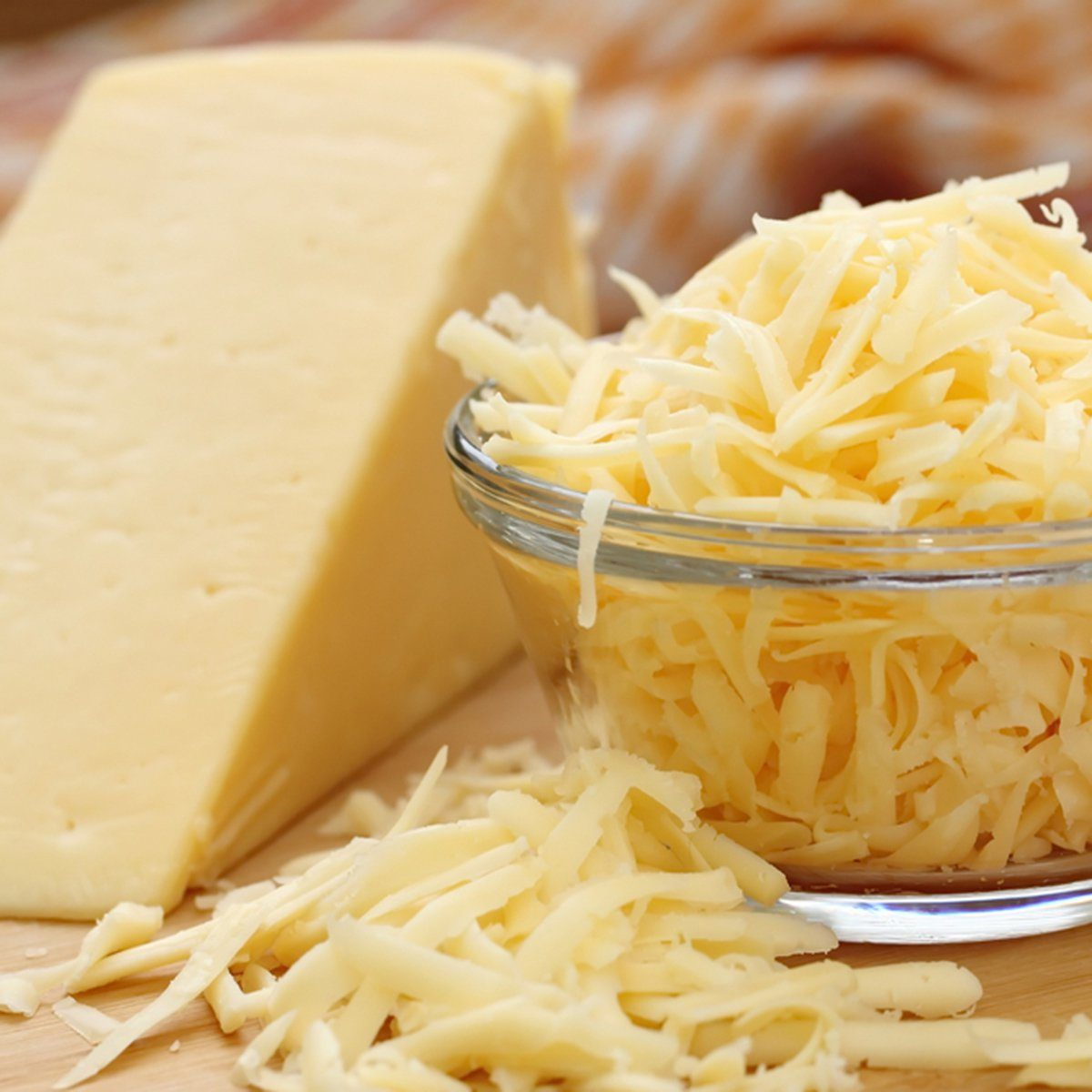Grated cheese in a glass bowl; Shutterstock ID 365625941; Job (TFH, TOH, RD, BNB, CWM, CM): TOH