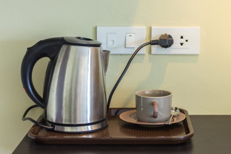 Cups and electric kettle was plugged in.
