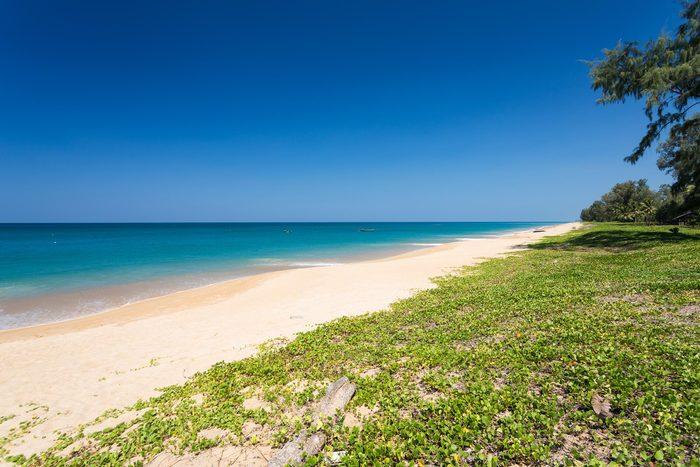 Amazing blue sky and calm Andaman sea on Mai Khao beach in Phuket Thailand
