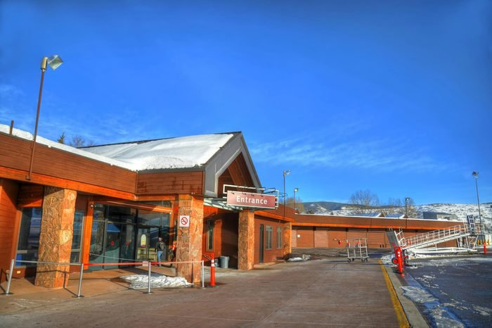 The entrance to Aspen-Pitkin County Airport (ASE) on a clear blue sky (HDR image)