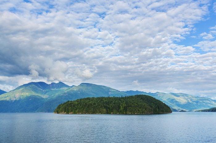 Beautiful seascape along Pacific coast of British Columbia, Canada, with rocky shoreline.