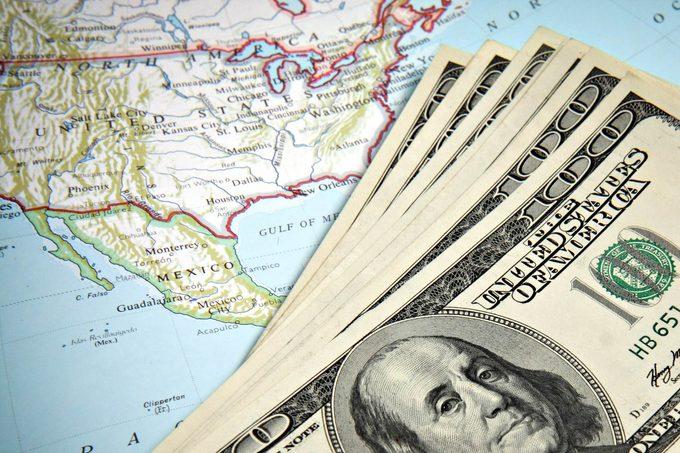 US map with 100 dollar bills