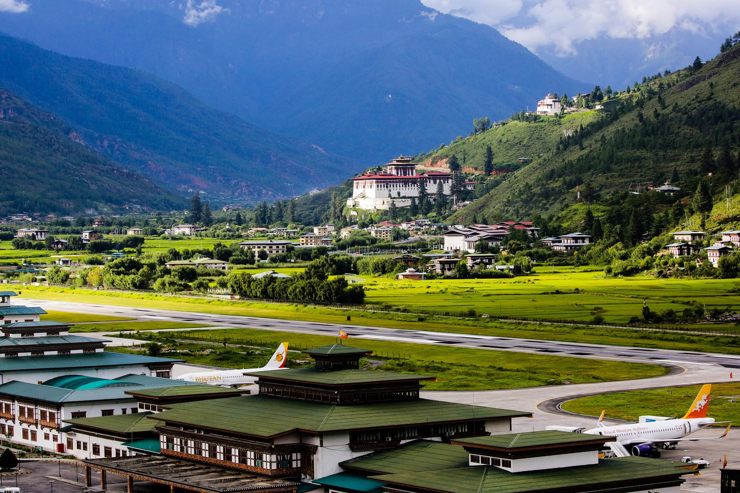 Paro Rinpung Dzong with Paro International Airport in the foreground