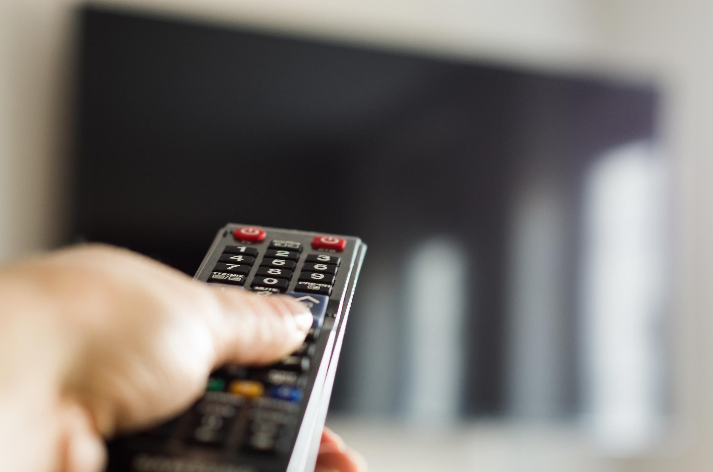TV remote control, the hand with a remote control.