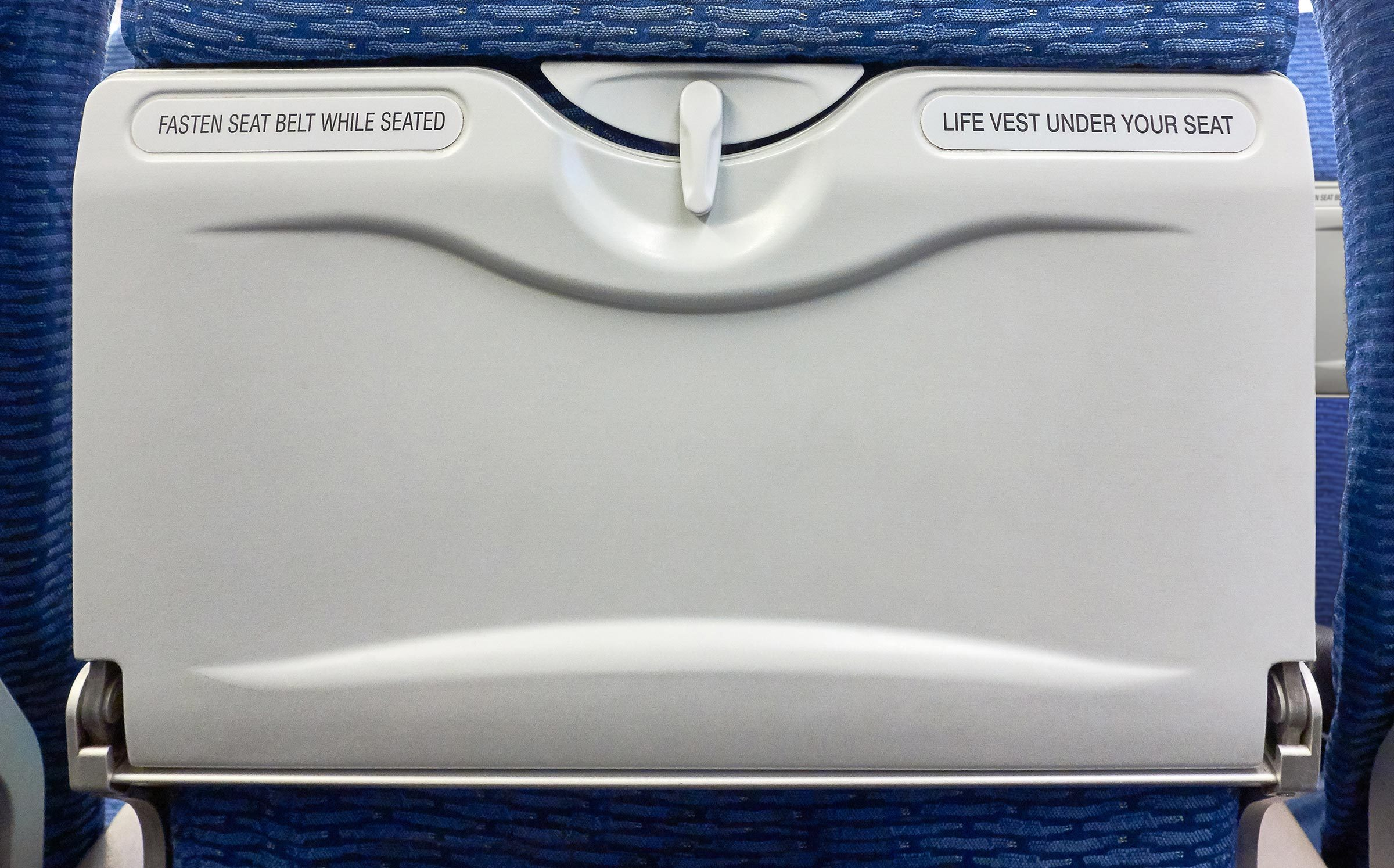 Airplane Tray Table on seat back for mockup banner or design advertising on blank area, already closed, copy space