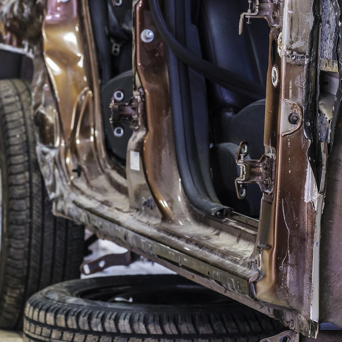 car damage body shop change tire
