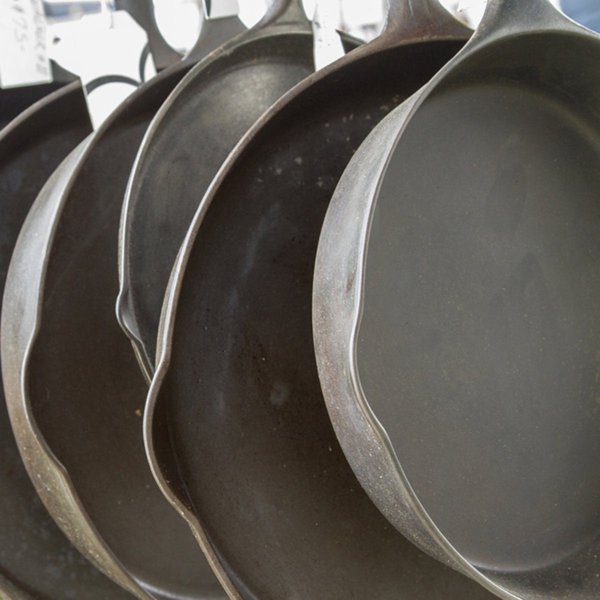 Hanging row of cast iron skillets at swap meet