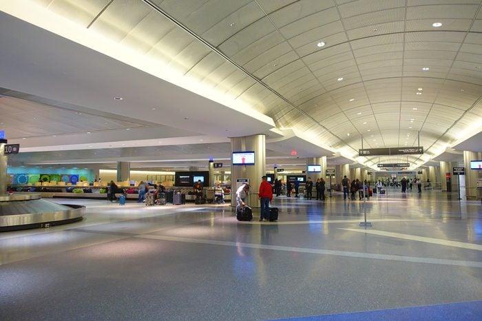 HOUSTON, ESA SEPTEMBER 19, 2017: Unidentified passengers walking with lugagge in airport Houston Intercontinental Airport, Houston, TX