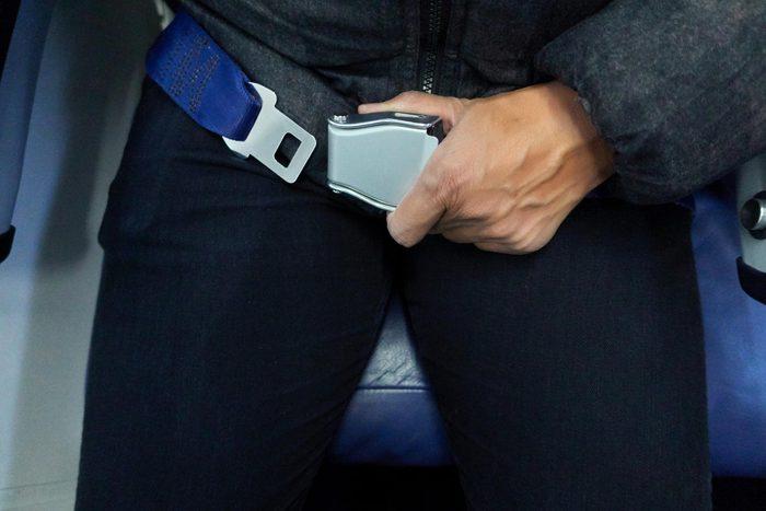 Passengers prepare fasten seat belt before the flight.