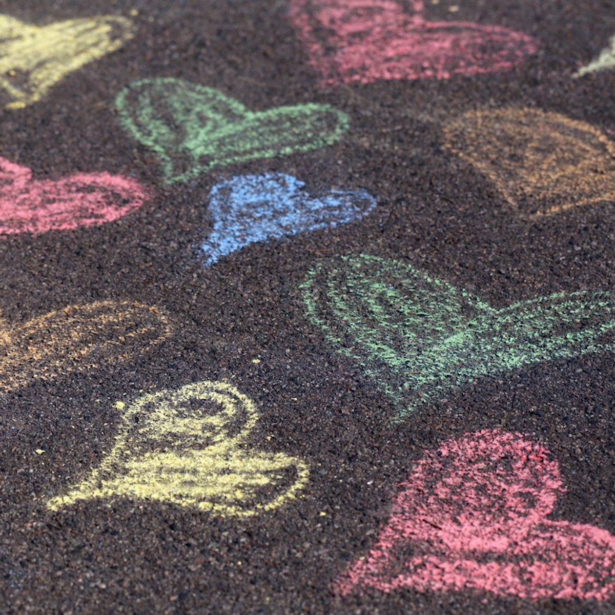 Chalk drawings on asphalt;