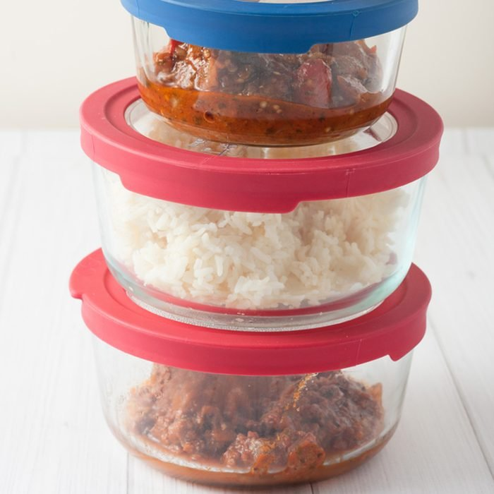 isolated close up of stack of glass containers with leftovers